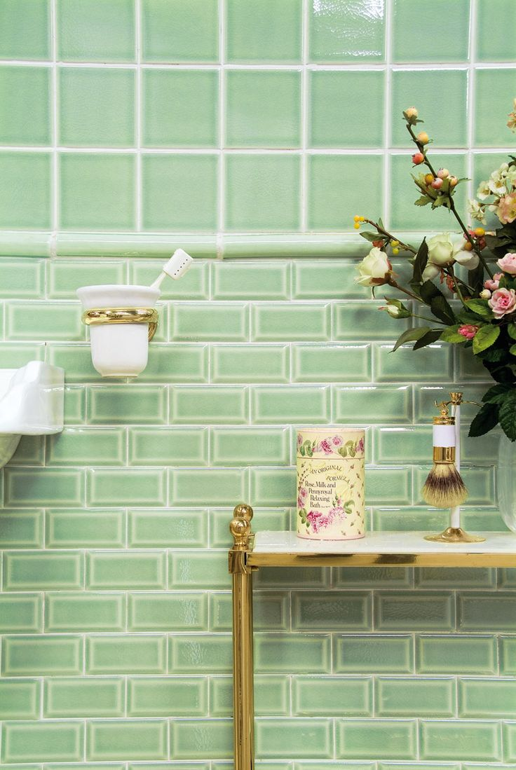 Traditional bathroom design featuring classical green crackle gaze wall tiles. Classic design, brick sized metro tiles.