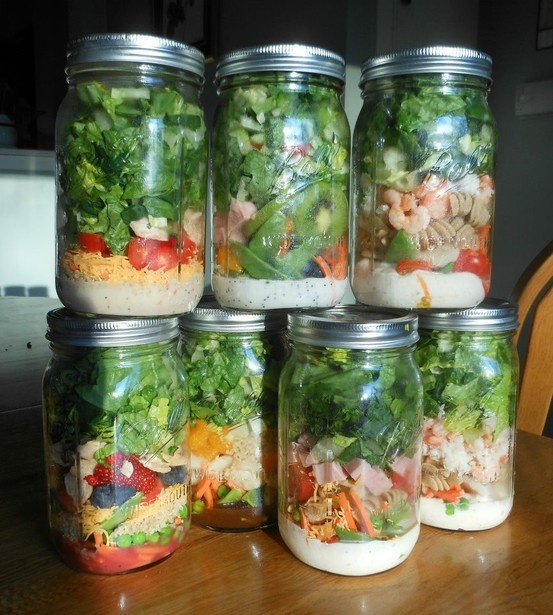SALAD IN A JAR - THE ARRANGEMENT From BOTTOM to TOP: Dressing Shredded carrots Cherry tomatoes Sunflower seeds Hard boiled eggs Baby spinach DIRECTIONS 1) Arrange ingredients in a large mason jar 2) Store in fridge for up to a week 3) When ready to eat: shake jar, place on a plate, and eat!  You can make any arrangement you want… you can add red onion, cucumbers, radishes or peppers. Always remember to put the dressing at the bottom and the lettuce at the top—a MUST.