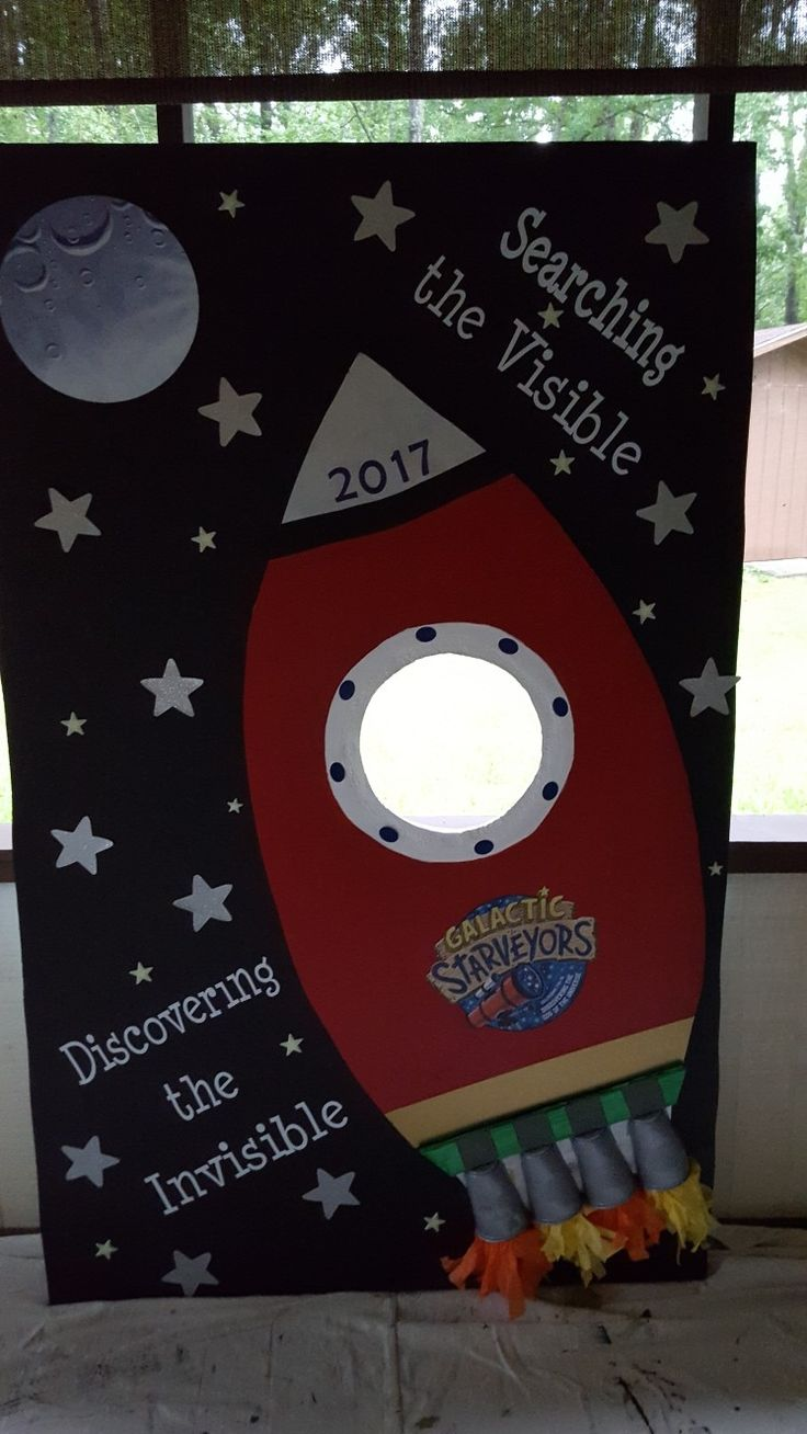 There is a hole in space ship for kids to put face for picture