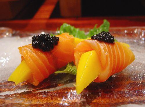 Salmon sashimi wrapped around mango
