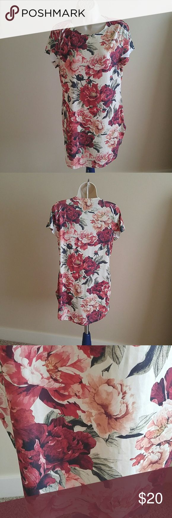 Ivory brushed midi dress Brand new just no tag. A flowers design midi dress the fabric is stretchy and it fitted to the body to show your curve. It can wear by the petite or medium size woman  we store our product in a smoke free home and we promise to ship our product as soon as we can Dresses Midi