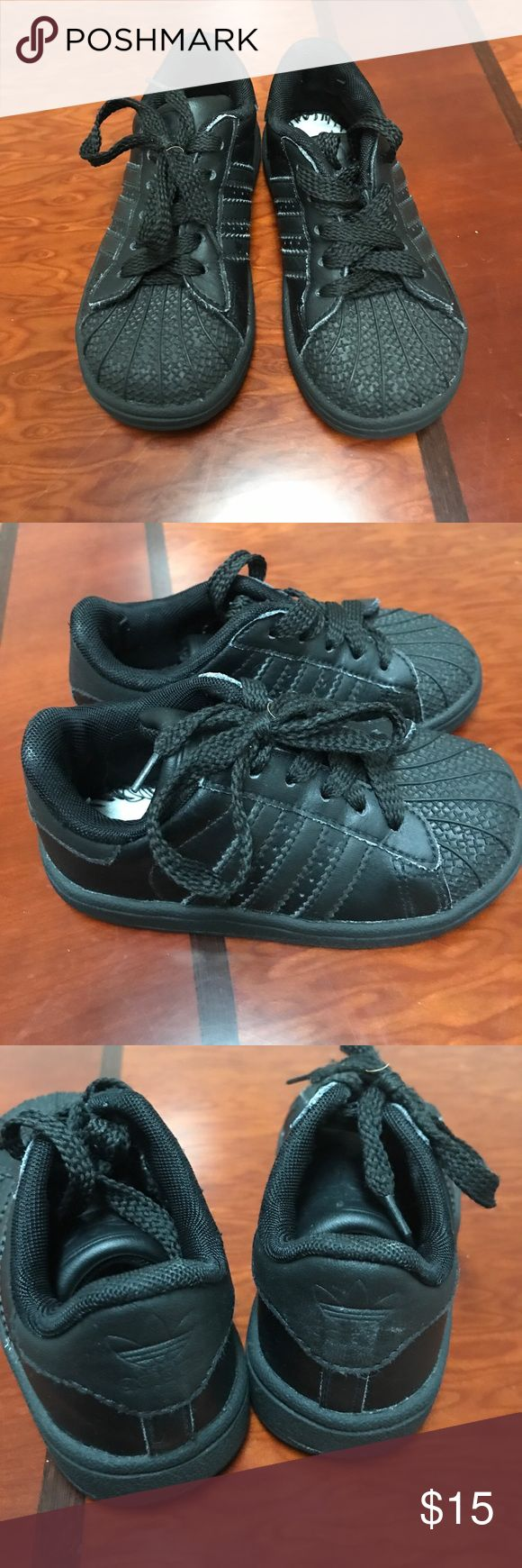 Adidas Black Toddler Sneakers 7 In good condition a pair of Adidas black toddler sneakers size 7. The insoles are missing but other wise shoes have lots of love to give. adidas Shoes Sneakers