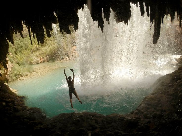 Leaping into Rock Falls from a cave behind the cascade in Havasupai, Arizona. See more photos from @outdoorwomen's photography ambassador, Kat Carney.