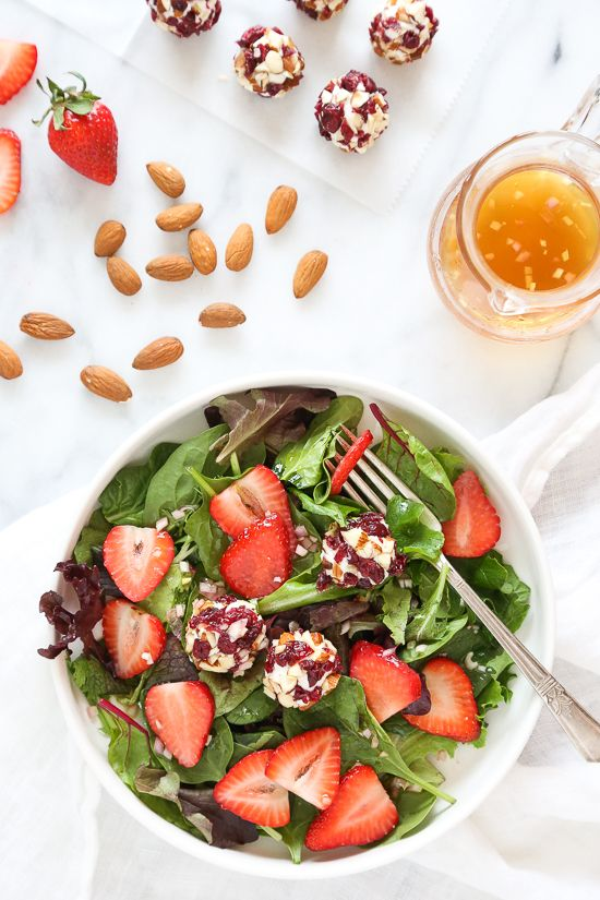 This beautiful Spring Berry Salad with Almond-Cranberry Crusted Goat Cheese is studded with strawberries and served over baby greens, but you can use any seasonal berries or a combination of berries instead. Serve this salad alone or alongside grilled chicken or fish. from @skinnytaste