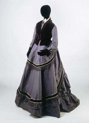 "Grey silk taffeta and velvet ensemble (front view), 1868-70. Ensemble consisting of a bodice, skirt and sleeveless jacket. Said to have been worn by a ""city merchant's wife""."
