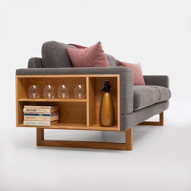 The Soft is a 3 seater sofa made from birch and oak wood. Its foam and wadding filling ensures maximum comfort. The sofa features a subtle bookcase module inbuilt on the side for unexpected storage. 85 cm h x 222 cm x 100 cm d. Please allow 5-7 weeks for shipping.