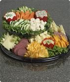 Tiered Variety Platter (D6) Fresh cut vegetables, dill dip, spinach dip, honey mustard dip, beef summer sausage, grapes and cracker-style cheeses, including Swiss, Danish Havarti, Colby and marbled cheese.