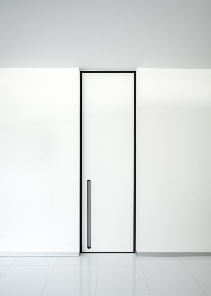 Modern White Interior Door With A Black Door Frame And Vertical Built In  Handle By