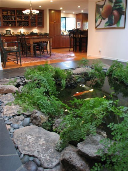 Love how the dining area opens up to a koi pond (I'd have it so that it wound its way further out to a much larger pond - more space for the fishes to swim around in freely).