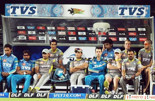 Pune Warriors India cricketer Sourav Ganguly (C) sits with support staff in the dug-out during the IPL Twenty20 cricket match between Pune Warriors India and Royal Challengers Bangalore at The Subroto Roy Sahara Stadium in Pune on May 11, 2012.