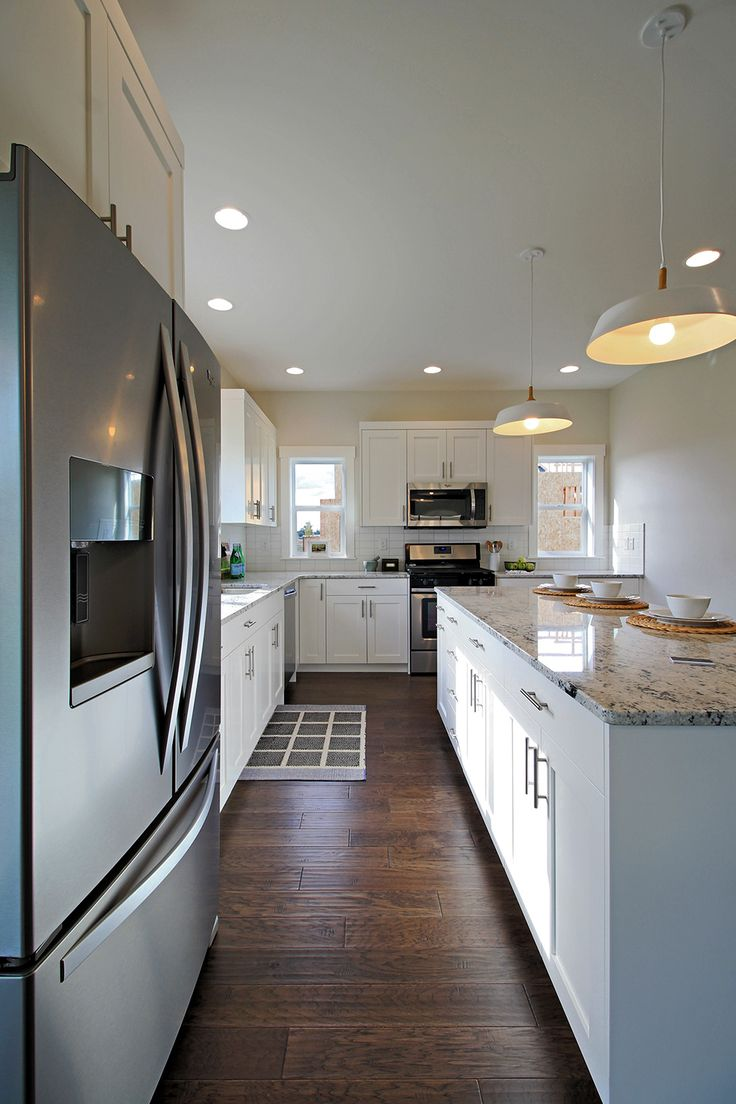 l shaped kitchen with white shaker cabinets colonial