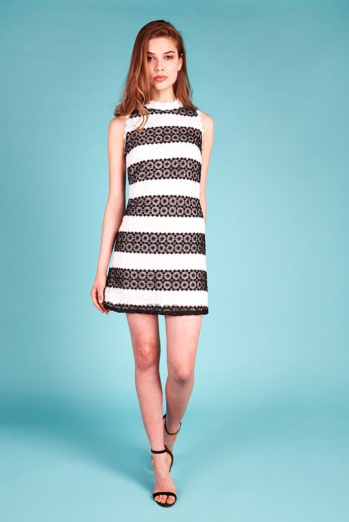 """For a chic 60s dressed-up look this season, opt for a monochrome shift dress. Defined by its intricate lace overlay, this black and white striped occasion dress speaks volumes in elegance. An on-trend high neck with lace trim is a stunning finishing touch and suits sleek drop earrings. Style with a small black clutch and black peep-toe heels for that """"wedding guest to remember"""" look. <p></p><li> Black and white striped sleeveless shift dress </li> &..."""