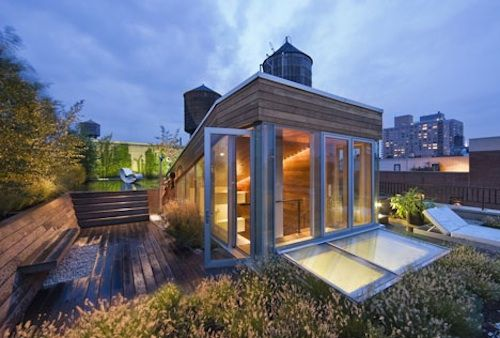 New York architect Joel Sanders has literally provided an escape hatch for a pair of New York City dwellers with this popped out penthouse roof deck cupola that provides access to a roof terrace planted with sedum and grasses.