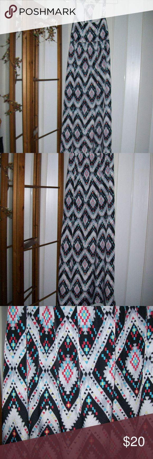 """love FIRE Vibrant Multi Color Maxi Dress NEW Beautiful vibrant multi color print maxi dress from .....love FIRE..T-Back with light elastic in the back as well. 100% polyester and Measures 59"""" long and 16"""" across the chest. Size Medium.  New Without Tags! No Defects and Thank You For Looking! love FIRE Dresses Maxi"""