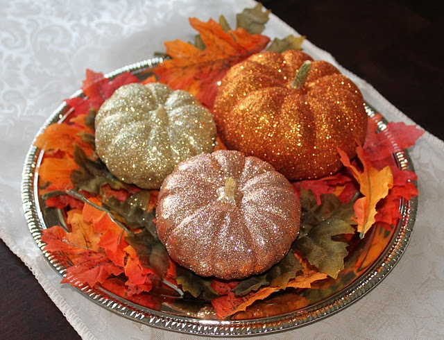 Martha Stewart's version of these were the inspiration for our DIY fall wedding centerpieces.... so simple and fun!