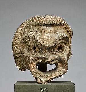 Water spout in the shape of a theatre mask. Roman, 50 BC-50  Fired clay. 16,2 cm
