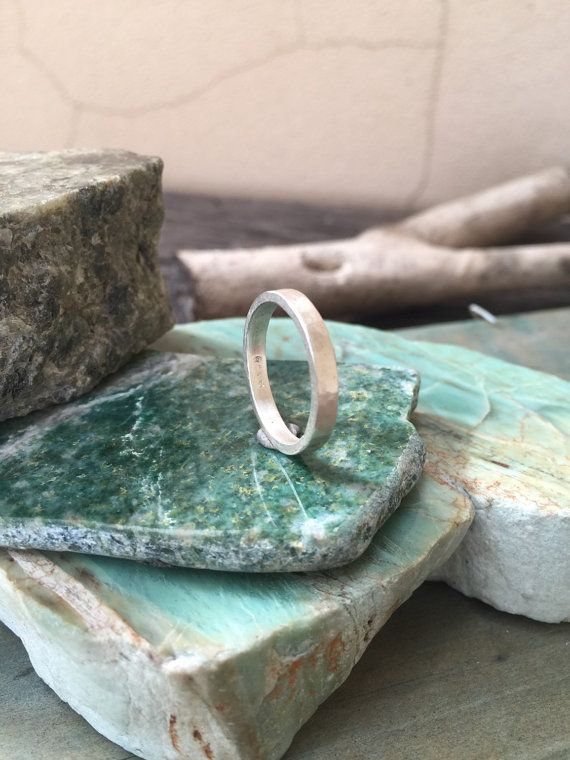 This stacking ring is made from 100% sterling silver and is gently hammered to give a reflective finish, the profile is square so it is denser and more solid than its slim profile might suggest. It looks great on its own, and also fits well with other skinny stacking rings.  Band width is approx 3mm  Size UK O. US 7.5    Can be made to order to size. | Shop this product here: spreesy.com/SilverPinions/85 | Shop all of our products at http://spreesy.com/SilverPinions    | Pinterest selling…