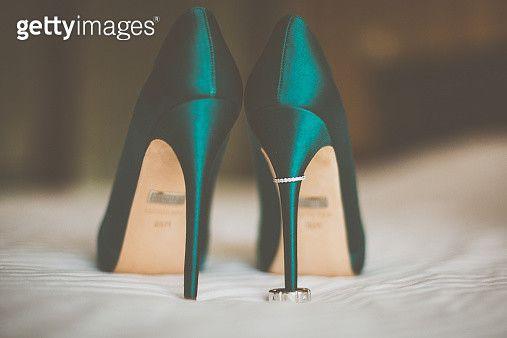 Wedding rings on green high wedding heels - gettyimageskorea