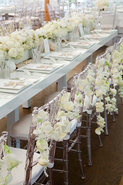Wedding party reception table linen chair decorations for Decorating chairs for wedding reception