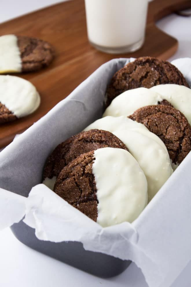 Soft And Chewy Crinkled Ginger Cookies Dipped In Creamy White