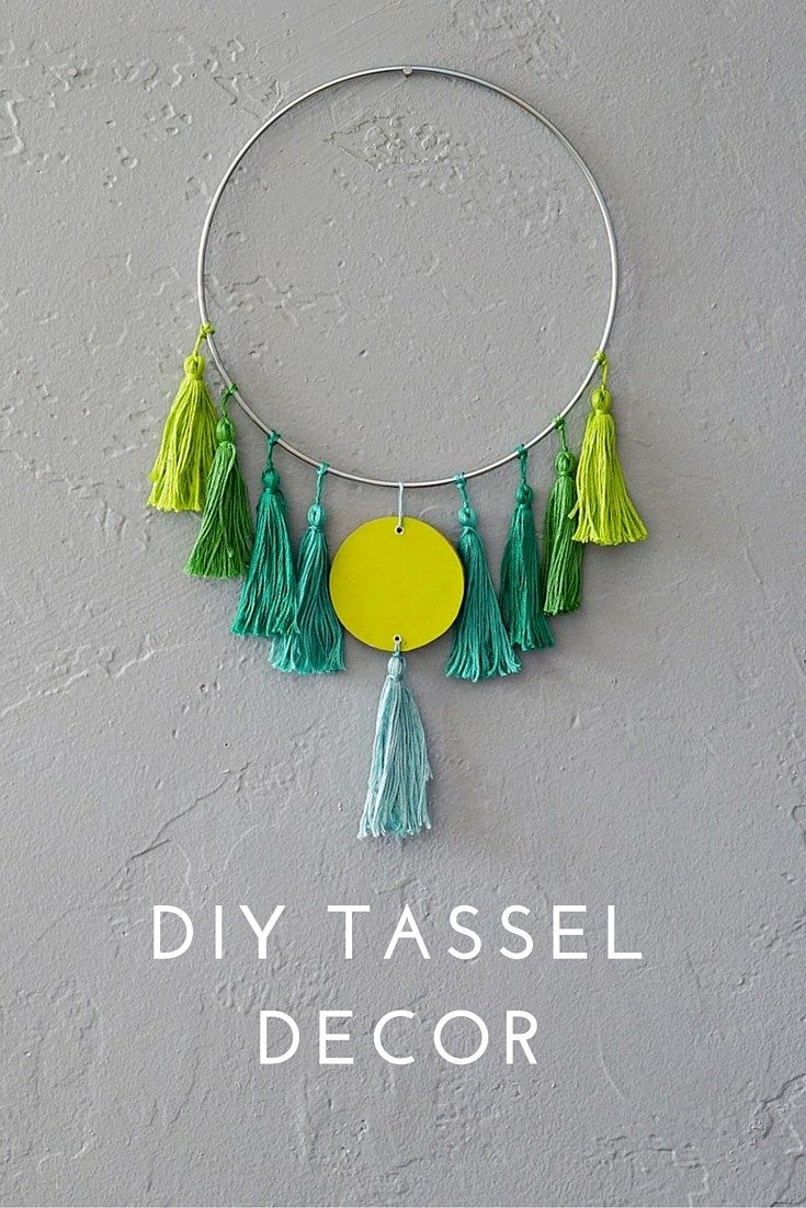 A DIY Tassel is an easy, budget-friendly way to kick up your home decor a notch or two! So many color variations and possibilities too! Click through for a tassel tutorial and design inspiration.