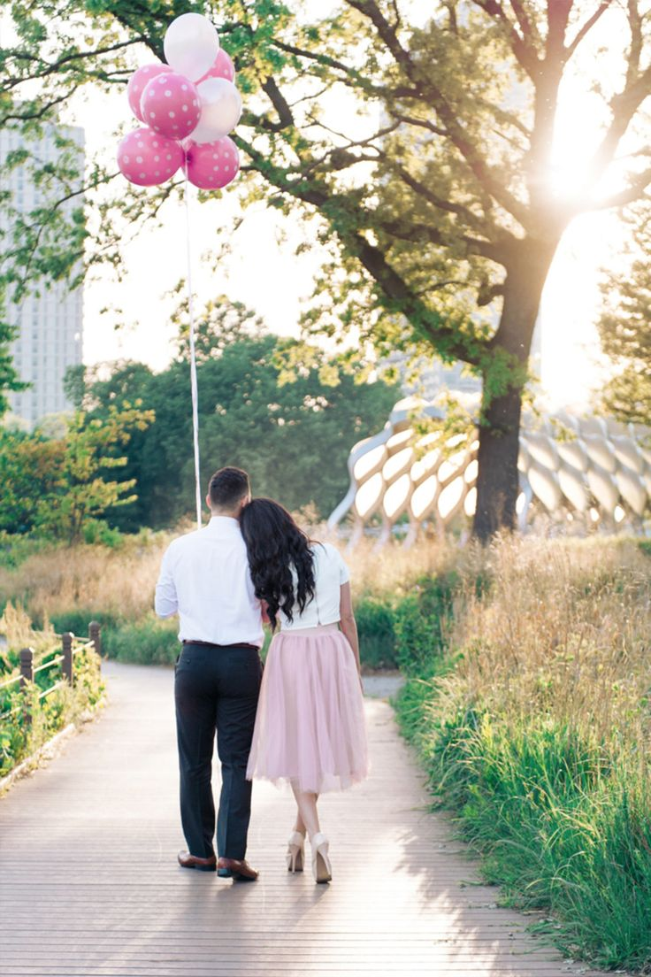 whimsical engagement photography pose idea with balloons