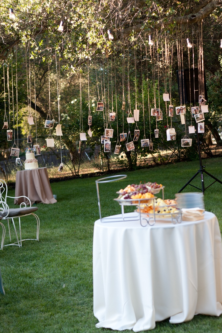 Bride and groom picture display bridal shower for Outdoor wedding bathroom ideas