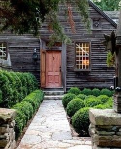 Red door: Red Doors, Boxwood Gardens, New England, Woods Side, Country House, Dreams House, Front Doors, Shrub, Dark House
