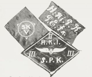 HK10000:6765 punakaartin jäsenmerkkejä