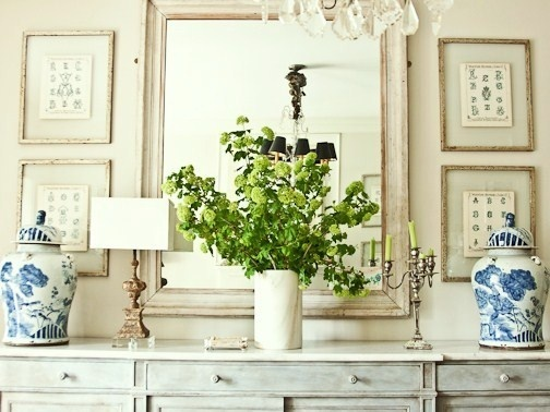 more really awesome green branches in a vase.  like the symmetrical arrangement.