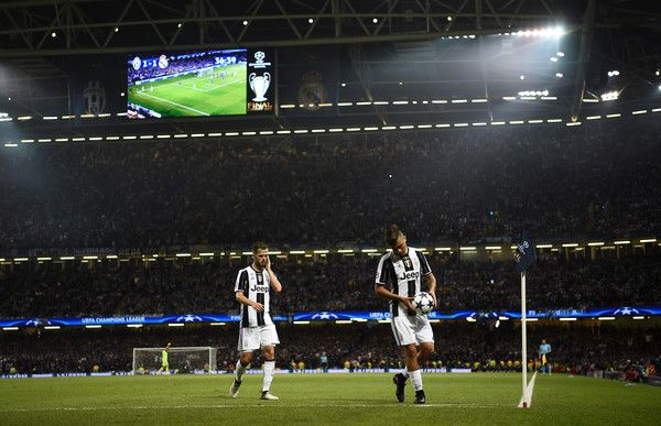 Paulo Dybala of Juventus places the ball down for a corner during the UEFA Champions League Final between Juventus and Real Madrid at National Stadium of Wales on June 3, 2017 in Cardiff, Wales.