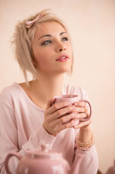 Picture of short hair cut on a pretty girl drinking coffee. Sexy but still very feminine.  Many short haircuts have a lot of different styling options that are all easy to do.