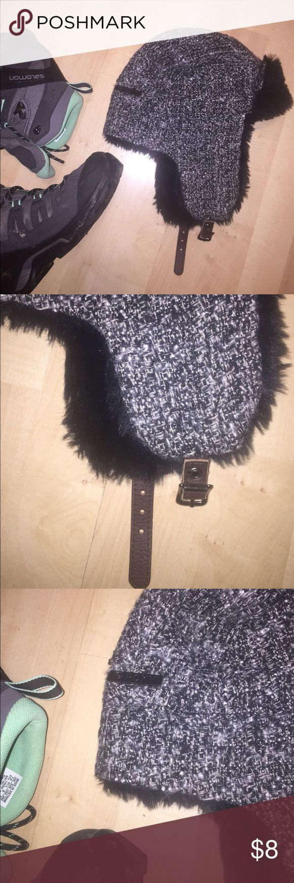 Roxy Lined Winter Hat Black and white knit outer shell with faux black fur inside. Ear flaps and brown faux leather buckle. Roxy Accessories Hats