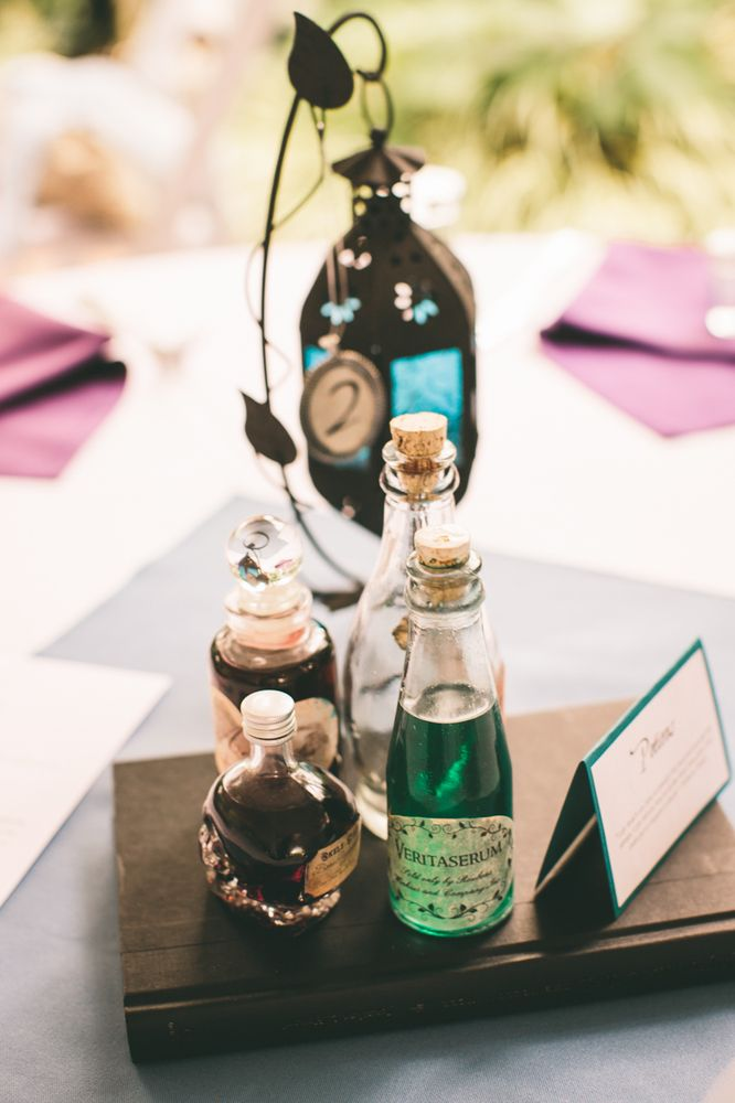 Looking for Harry Potter wedding ideas? Name your tables based on Hogwarts classes like Potions and decorate the them accordingly
