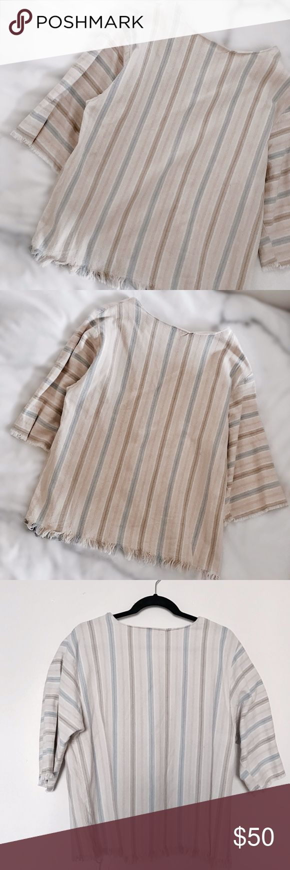 """""""Beach Fray"""" Stripey Linen Top Vintage, stripey linen top with a semi-structured fit and baby-frayed hem. Super relaxed and great to layer over sweaters and button-ups for an interesting look this winter, or take it on a warm holiday. 3/4 sleeves and open neck to enhance collarbones.  Fits like a size M but looks great for anyone size XS/S as well-- 25""""L, 19""""p to p. Retail value $100. -Olivia Cheng Curated Vintage- Vintage Tops"""