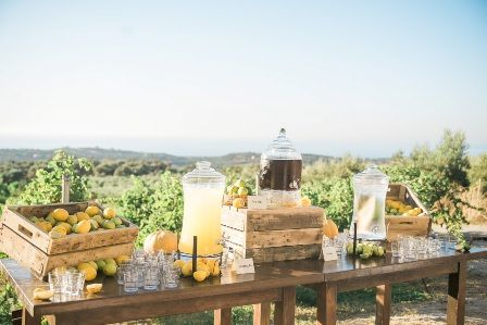 Refreshing fresh juices on eye-catching drinks table with amazing panoramic views for fairytale wedding at traditional private estate in Crete. Moments www.weddingincrete.com