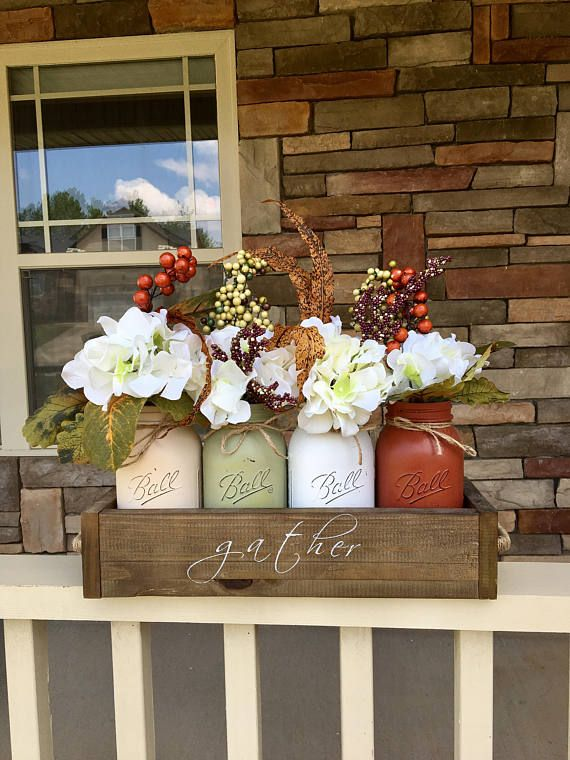 Fall is right around the corner and what better way to decorate your home than with a mason jar fall centerpiece.. Package includes: (1) Hand crafted planter box with hand painted stencil 16.53.55.5 WITHOUT HANDLES (2) Installed handles (4) chalk painted mason jars (4) Floral