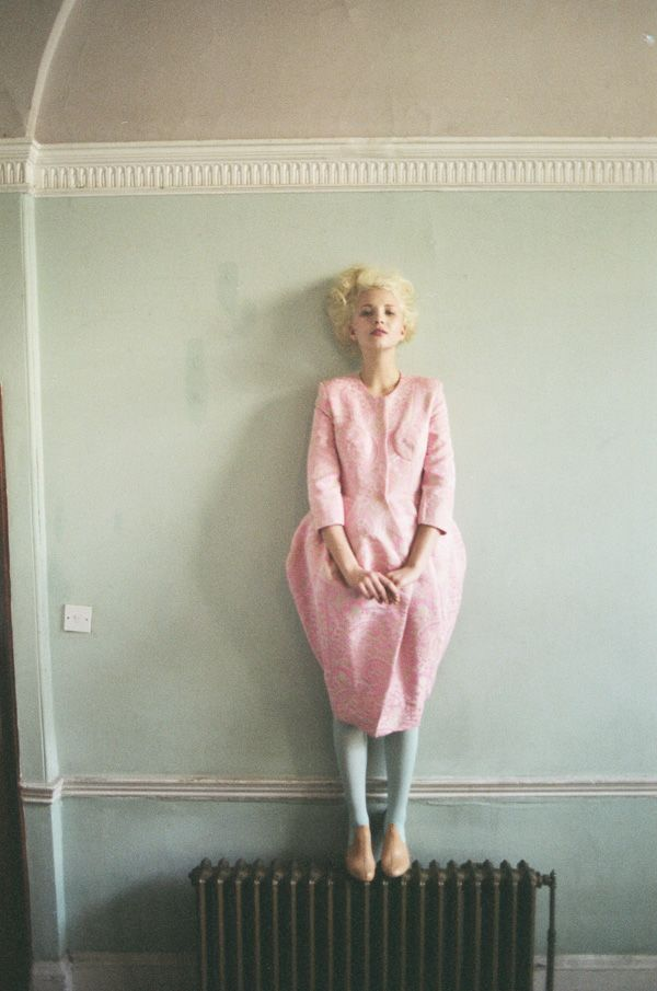 This is a fine radiator, but just look at the pastel of the dress against that pale blue wall!
