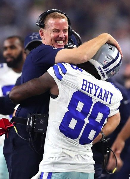 Dez Bryant Photos Photos - Head coach Jason Garrett of the Dallas Cowboys celebrates with Dez Bryant #88 after Bryant threw a touchdown pass against the Detroit Lions during the second half at AT&T Stadium on December 26, 2016 in Arlington, Texas. - Detroit Lions v Dallas Cowboys
