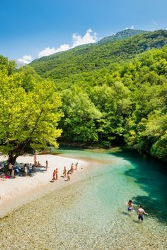 Swimmers and bathers on the beach banks of the Voïdomatis River in the Zagorohoria in Greece.