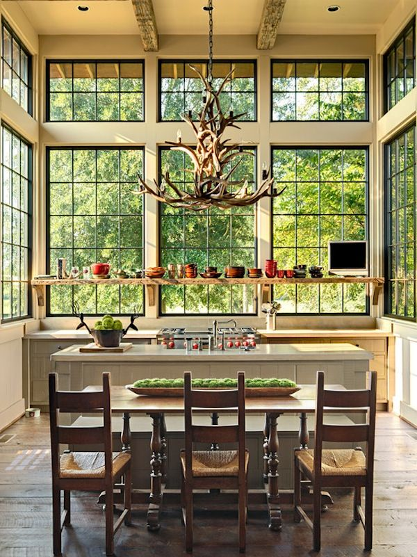 Tall ceilings and large #windows make this #kitchen and #dining #room combination look spacious and #beautiful. Love all of the #natural elements.