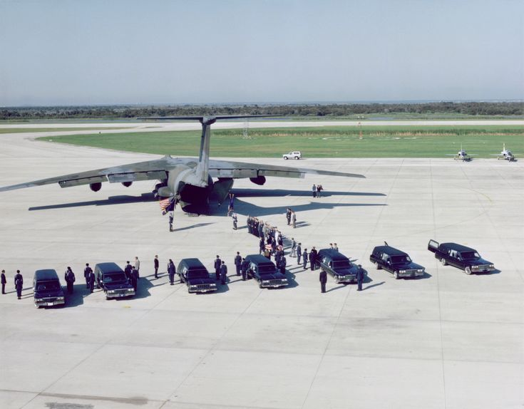 Space Shuttle Challenger disaster 1986 - The remains of the Challenger crew are transferred to a C-141 at the NASA KSC Shuttle Landing Facility, bound for Dover Air Force Base, Delaware