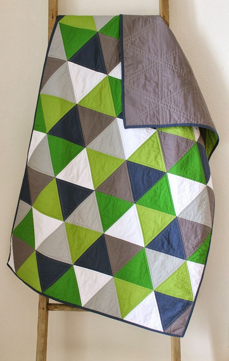 Navy and green equilateral triangle quilt.