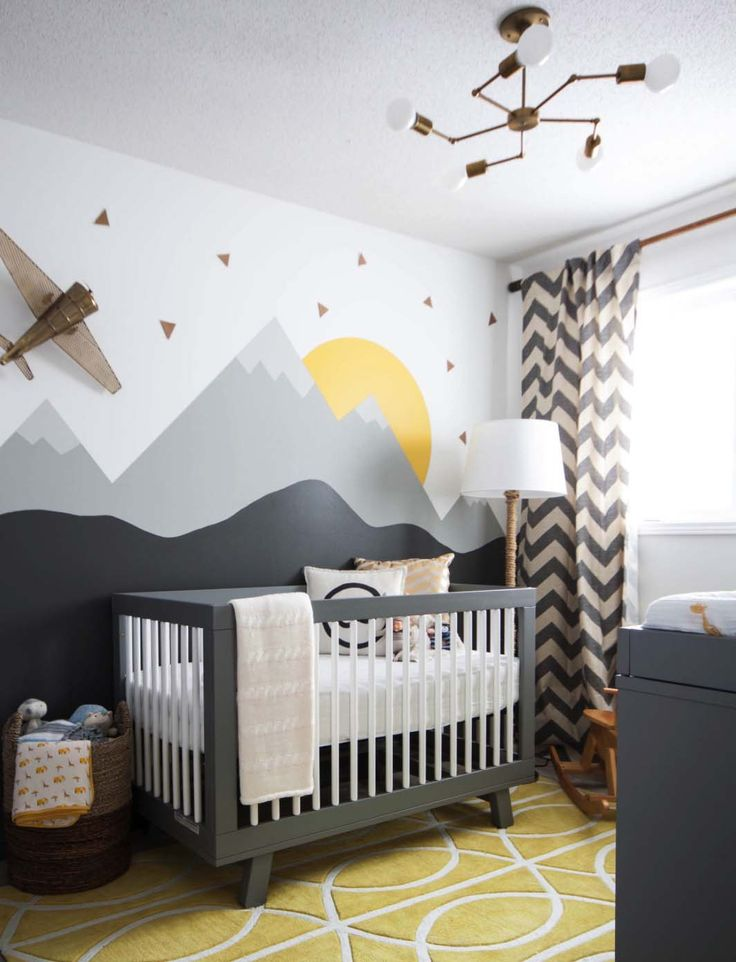an excellent example of a gender neutral nursery, in grays, yellows and whites. Modern, comfortable and still a very stylish nursery!