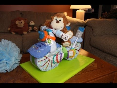 In this video Thom shows you how to make a cool Motorcycle Diaper Cake for Boys. A fun and unique way to show friend or family how much you care at the next Baby Shower.    Motorcycle Diaper Cake - How To Make - Baby Shower - Gift