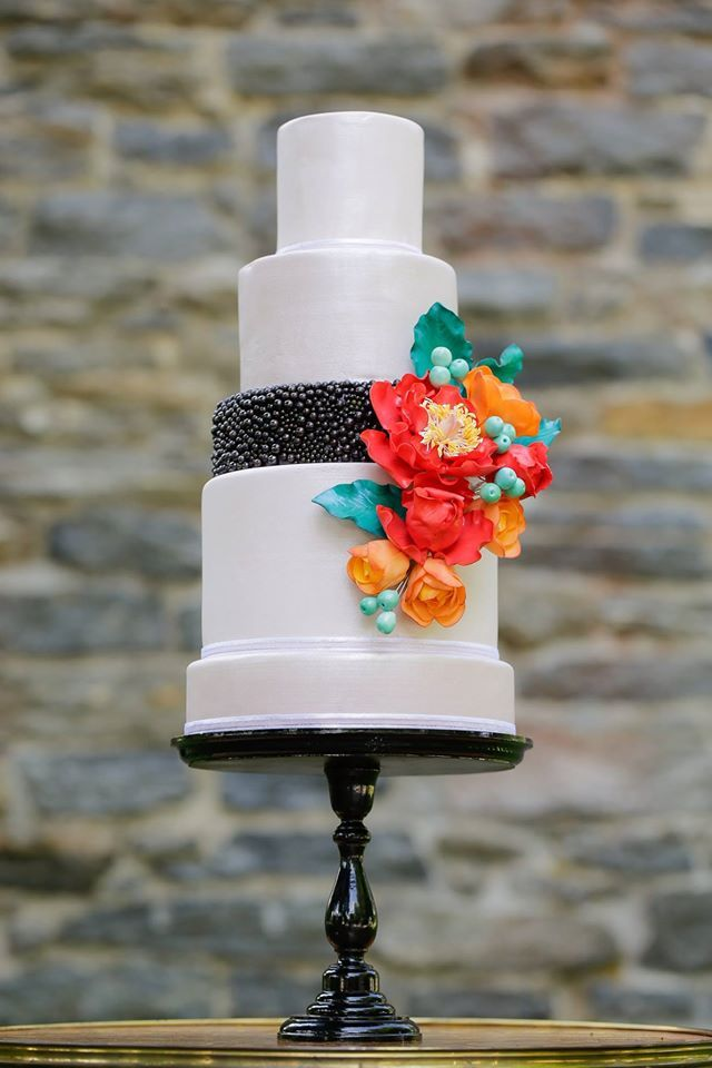 Single dark pearlized layer and bright pop of flowers #unique wedding cake ideas