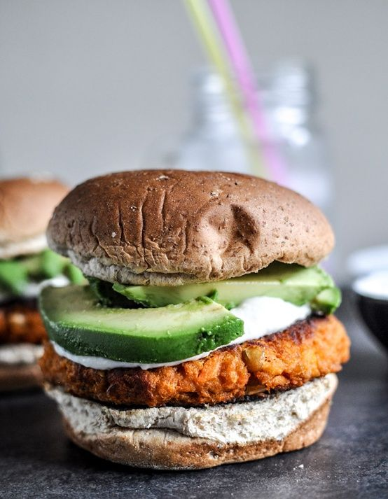Smoky sweet potato burgers with roasted garlic cream and avocado. Tons of ingredients, but looks soooo good.