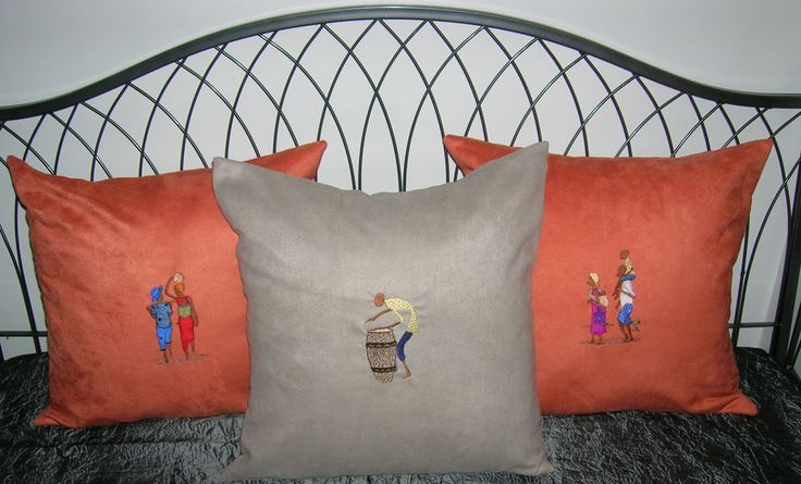 Embroidered throw cushions.