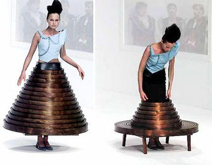 It's a table, no it's a dress. By Hussein Chalayan. I'd love to see one of his runway shows in person.