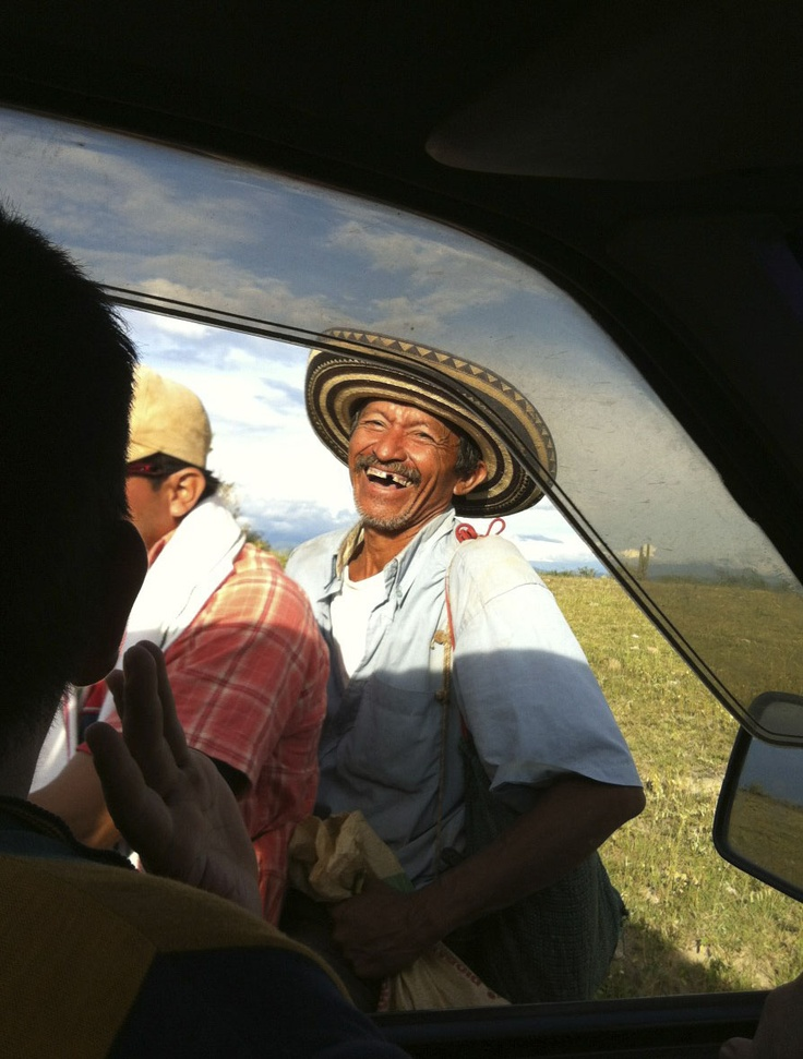 """""""This photo was snapped with my iPhone from the middle seat of a truck our production team was getting a lift in, across the dusty roads of the Colombia's Tatacoa Desert. I saw the moped approaching, snapped and just got lucky."""" Submitted by Willa K."""